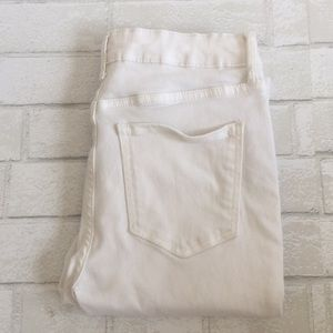 White skinny jeans with button fly size 4